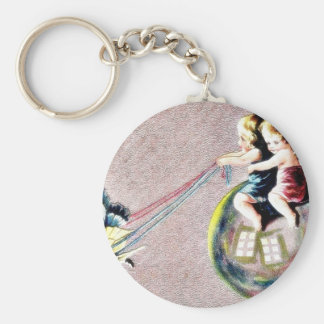 two kids riding a butterfly cart key chain