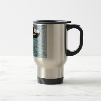 Two killer whales jumping out of water travel mug