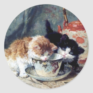 Two kittens having tea party classic round sticker