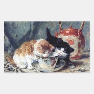 Two kittens having tea party rectangular sticker