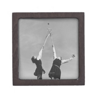 Two lacrosse players jump for the ball. keepsake box