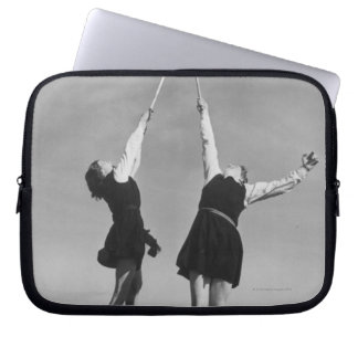 Two lacrosse players jump for the ball. laptop sleeves