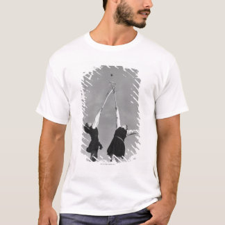 Two lacrosse players jump for the ball. T-Shirt