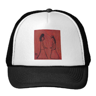 Two ladies greeting each other trucker hat
