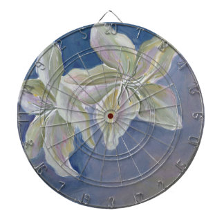 two lily flowers on blue dartboard