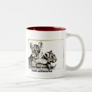 two lion cubs by kam-artworks Two-Tone coffee mug