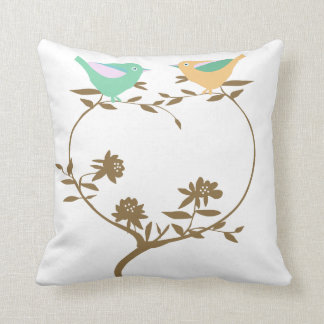Two little birds on a heart shaped branch throw pillow