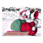 Two Little Girls pulling a Christmas Sled Post Card