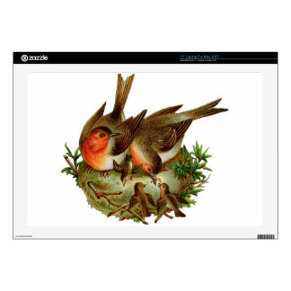 Two lovely adult Robins along with their Babies Laptop Skins