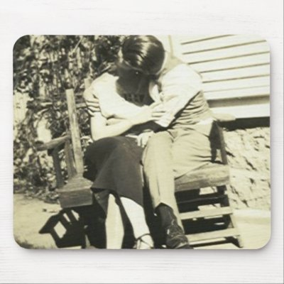 lovers kissing wallpapers. Two lovers kissing on a bench