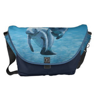 Two Manatees Swimming Courier Bag