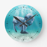 Two Manatees Swimming Round Wall Clock