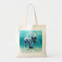 Two Manatees Swimming Tote Bag