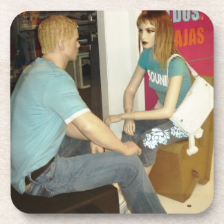 two mannequins face-to-face picture. a difference beverage coaster