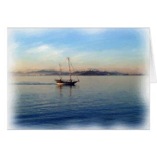 Two-Masted sailboat motoring on bay Card