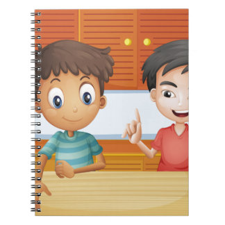 Two men inside the kitchen spiral notebooks
