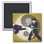 Two men performing martial arts in front of a 2 inch square magnet