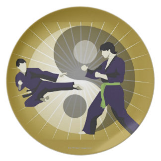 Two men performing martial arts in front of a dinner plate
