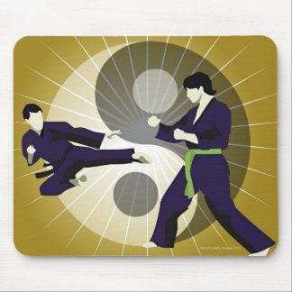 Two men performing martial arts in front of a mouse pad