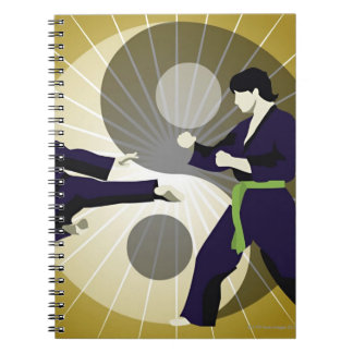 Two men performing martial arts in front of a spiral notebook