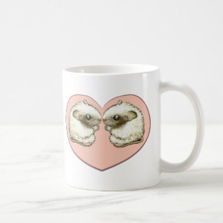 Two mice in a love heart coffee mugs