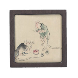 Two mice, one lying on the ground with head restin keepsake box