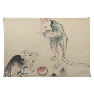Two mice, one lying on the ground with head restin placemat