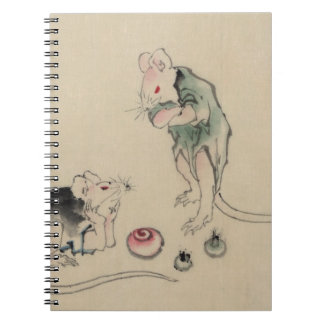 Two mice, one lying on the ground with head restin spiral notebook