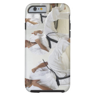 Two mid adult men with a young man practicing tough iPhone 6 case