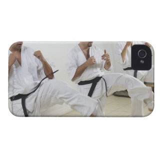 Two mid adult men with a young man practicing iPhone 4 cases