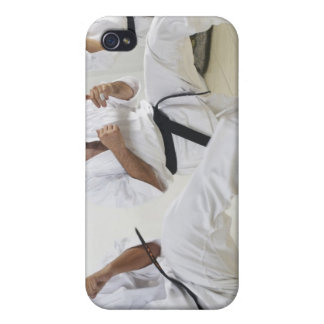 Two mid adult men with a young man practicing iPhone 4/4S case