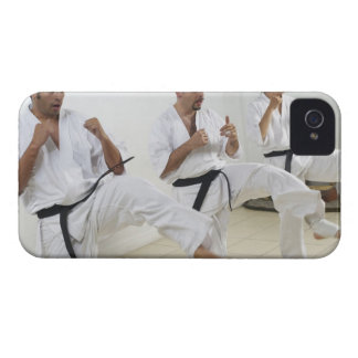Two mid adult men with a young man practicing iPhone 4 case