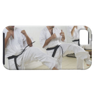 Two mid adult men with a young man practicing iPhone SE/5/5s case