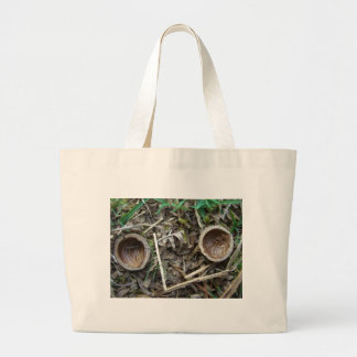 Two nut shell halves 1 canvas bag