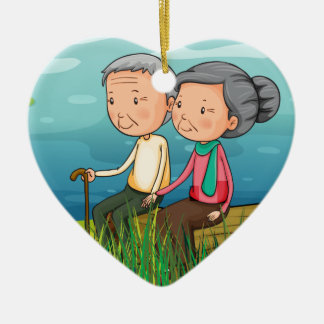 Two old people sitting near the lake ceramic ornament