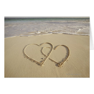 Two overlying hearts drawn on the beach card