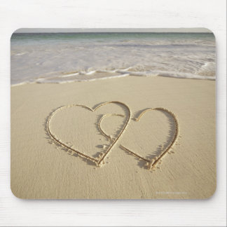 Two overlying hearts drawn on the beach mouse pad
