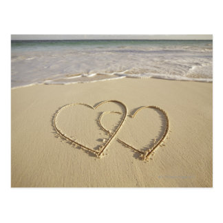 Two overlying hearts drawn on the beach postcard