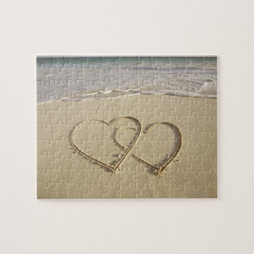 Two overlying hearts drawn on the beach puzzles