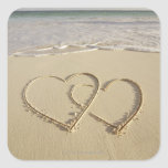 Two overlying hearts drawn on the beach square stickers