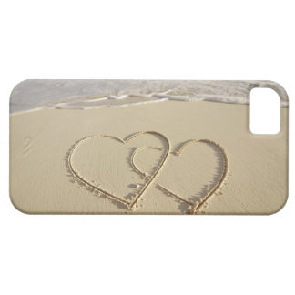 Two overlying hearts drawn on the beach with iPhone 5 case