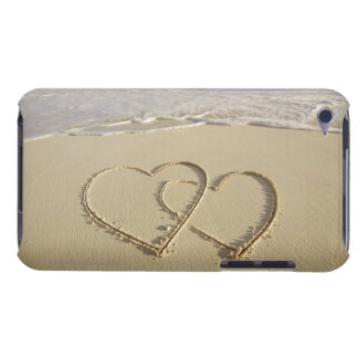 Two overlying hearts drawn on the beach with Case-Mate iPod touch case