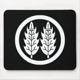 Two parallel holly leaves in circle mouse pad