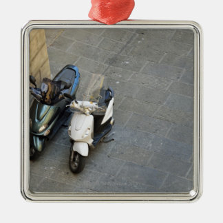 Two parked motor scooters by wall, Siena, Italy Metal Ornament