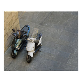 Two parked motor scooters by wall, Siena, Italy Poster
