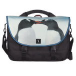 Two Penguins touching beaks Commuter Bags