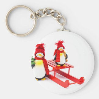 Two penguins with sleigh and christmas tree keychain