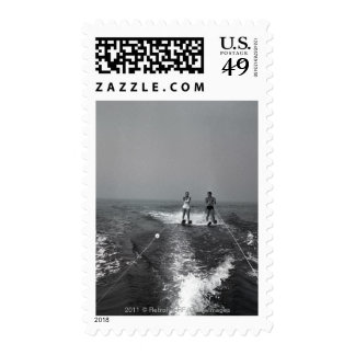 Two people waterskiing stamps