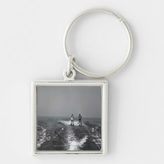 Two people waterskiing Silver-Colored square keychain
