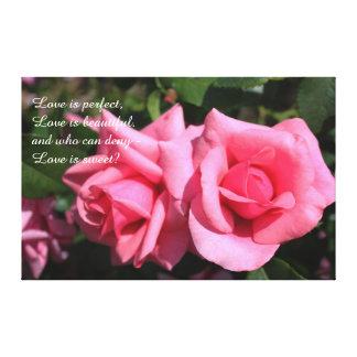 Two perfect pink rose flowers, love is sweet canvas print